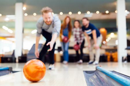 Friends bowling at club Stock fotó