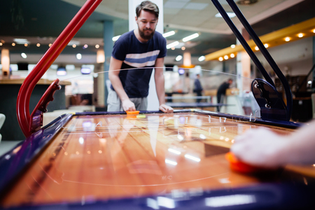 Air hockey is fun even for adults