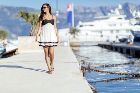 Beautiful woman in marina posing 写真素材