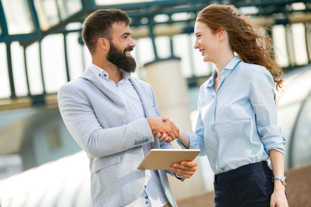 Picture of handsome man and beautiful woman as business partners