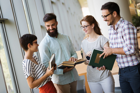Group of students discussing in university Stock Photo