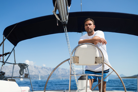Happy smiling man sailing with his yacht Stockfoto