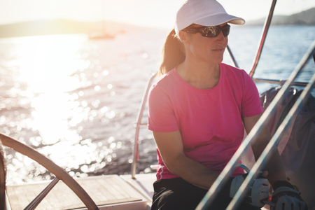 Happy strong woman sailing with her boat Stockfoto - 102595863