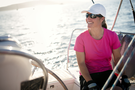 Happy strong woman sailing with her boat Stockfoto - 102595866