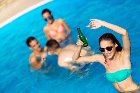 Group of friends partying in pool