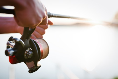 Fishing, hobby and recreational concept - fishermen