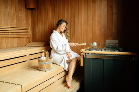 Beautiful woman in finnish sauna