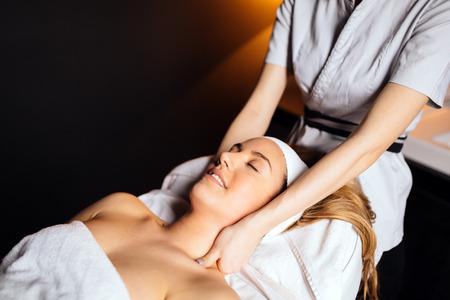 Beautiful woman enjoying massage treatment Stock Photo