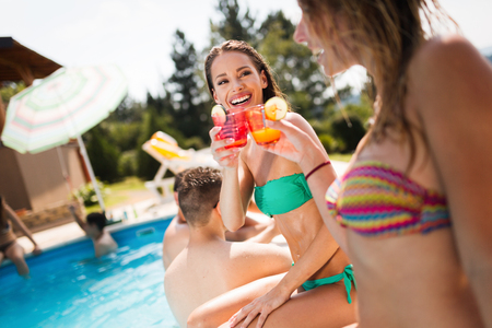 Group of young people enjoying summer at pool Stock Photo