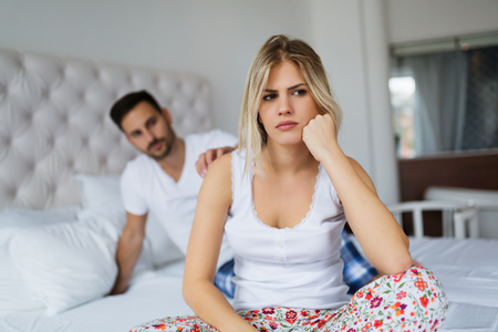 Young unhappy couple having problems in relationship