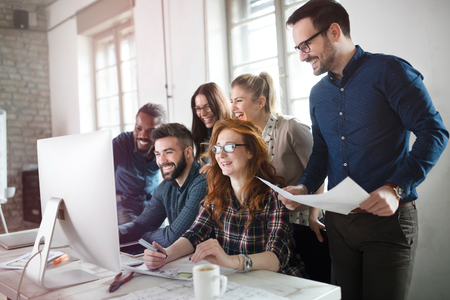 Group of young designers working as team Stock Photo
