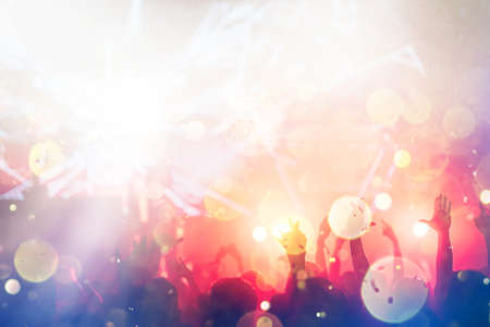 Cheering crowd with hands in air at music festival 스톡 콘텐츠