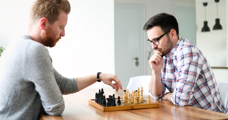 Two young man playing chess Stock Photo