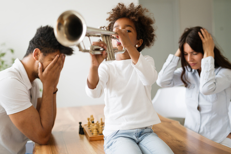 Picture of child making noise by playing trumpet