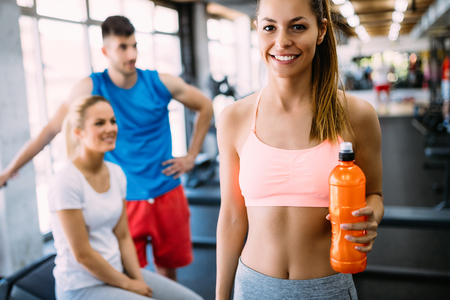 Sporty woman hydrating during workout Imagens