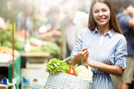 Picture of woman at marketplace buying vegetables 스톡 콘텐츠