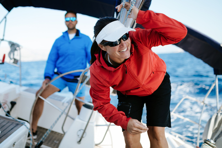 Attractive strong woman sailing with her boat Stockfoto - 106865479
