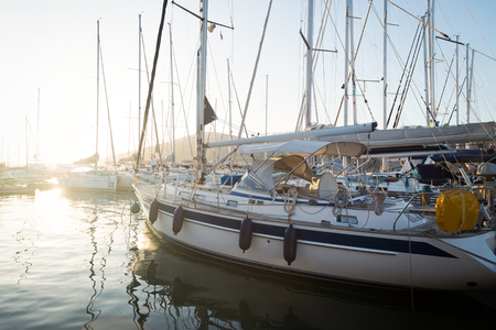 Picture of row of sailboats reflected in water
