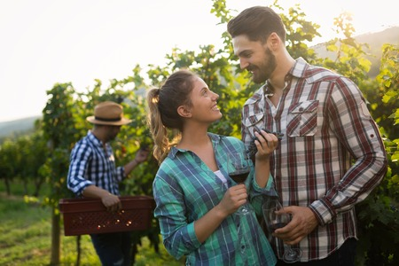 People sampling and tasting wines in vineyard Stock Photo - 107365847