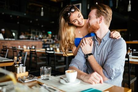 Beautiful man and woman flirt