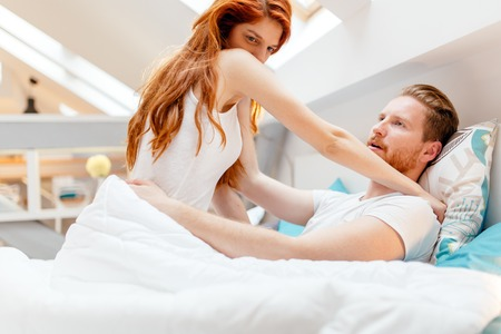 Woman thinking of ex in bed Stock Photo