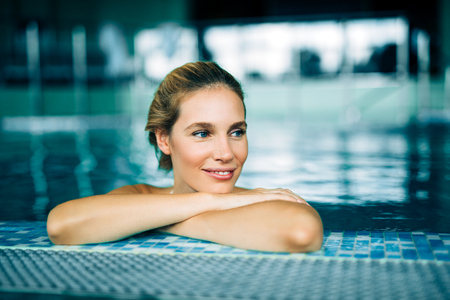 Portrait of beautiful woman relaxing in swimming pool Stock Photo