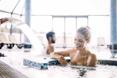 Portrait of beautiful woman relaxing in swimming pool Stockfoto