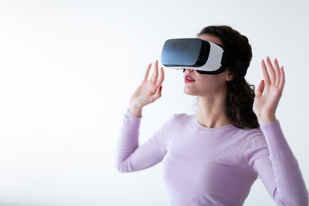 Young excited woman trying virtual reality headset Stockfoto