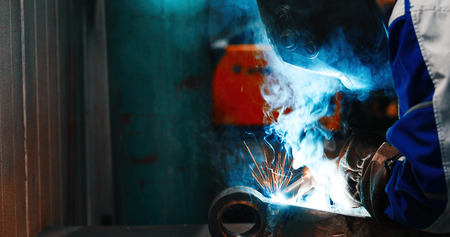 Metal cutting with acetylene torch in industry