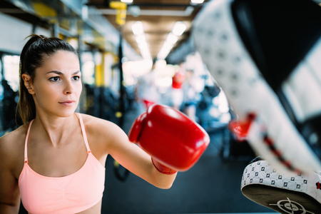Boxing workout woman in fitness class ring