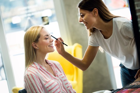 Make-up artist work on pretty woman