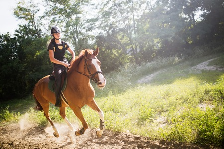 Portrait of young woman riding horse in countryside Reklamní fotografie
