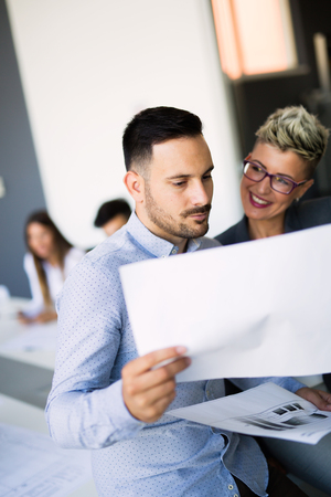 Businessman putting forward his suggestions to colleagues. Startup business team on meeting Stock Photo