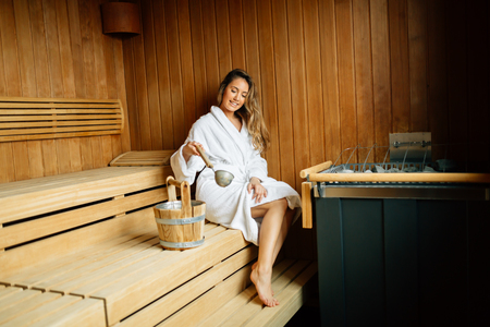Beautiful woman in finnish sauna