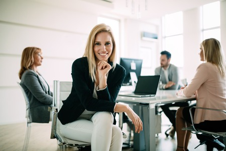Picture of attractive sales workers on meeting in office