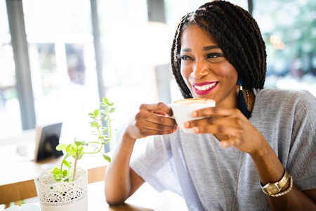 Portrait of an african american woman relaxing at cafe with coffee