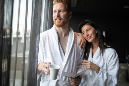 Happy couple enjoying treatments and relaxing at wellness spa center 版權商用圖片