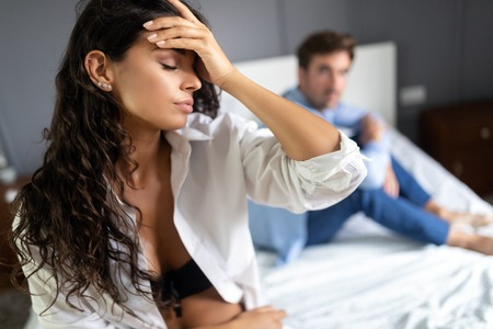 People, relationship difficulties, conflict concept - unhappy couple having problems at bedroom Stock Photo