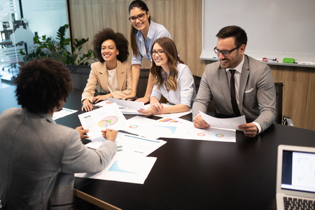 Successful group of business people at work in office Banco de Imagens