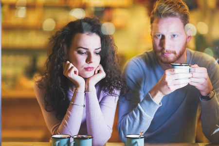 Young attractive couple having problems on date Stock Photo - 113024733