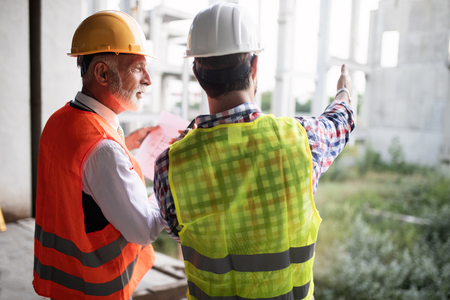 Team of architects and engineer in group on construciton site check documents and business workflow Stok Fotoğraf