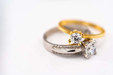 Engagement diamond wedding ring group on white background, diamond, golden rings