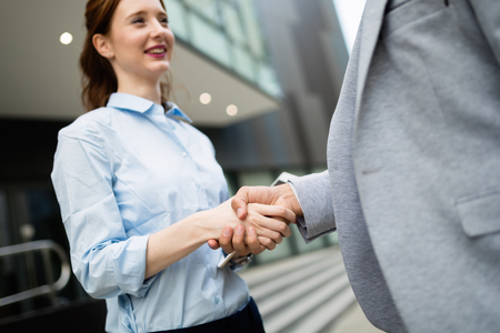 Business and office concept. Businessman and businesswoman shaking hands 写真素材