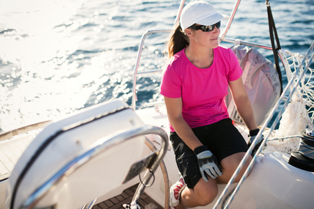 Happy strong woman sailing with her boat Stockfoto - 116270820