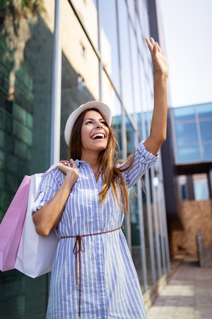 Shopping and tourism concept. Happy young oman with shopping bags Stock Photo
