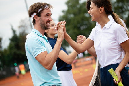 Group of tennis player handshaking after playing a tennis match. Fairplay, sport concept.