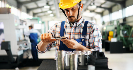 industrial factory employee working in metal manufacturing industry