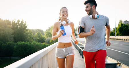 Attractive man and beautiful woman jogging together Reklamní fotografie
