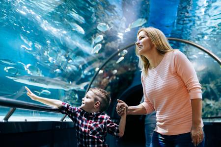 Mother and son watching sea life in oceanarium 写真素材