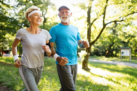 Beautiful sporty mature couple styaing fit with sport Stockfoto